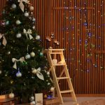 Stylish_room_interior_with_decorated_Christmas_tree