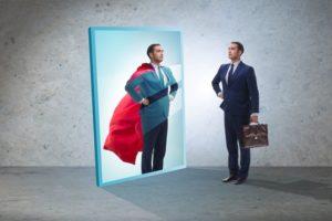 Businessman_seeing_himself_in_mirror_as_superhero
