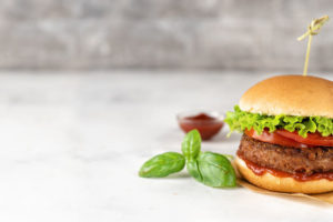 Vegan_burger_on_white_rustic_background._Copy_space._Banner