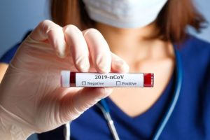 Beckmann_Coulter_Nurse_holding_test_tube_with_blood_for_2019-nCoV_analyzing.__
