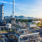 Aerial_view_of_chemical_oil_refinery_plant,_power_plant_on_blue_sky_background.
