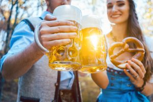 Couple_toasting_with_beer_in_Bavaria_in_fall_or_autumn_