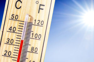 Thermometer_in_summer_day_shows_or_indicate_high_temperature_degree_with_sun_in_background._