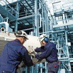industrial_workers_inside_oil_refinery