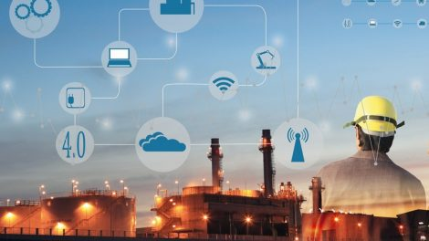 two_engineer_on_site_,_Industry_4.0_concept_image.Oil_refinery_at_twilight_with_cyber_and_physical_system_icons_diagram_on_industrial_factory_and_infrastructure_background.