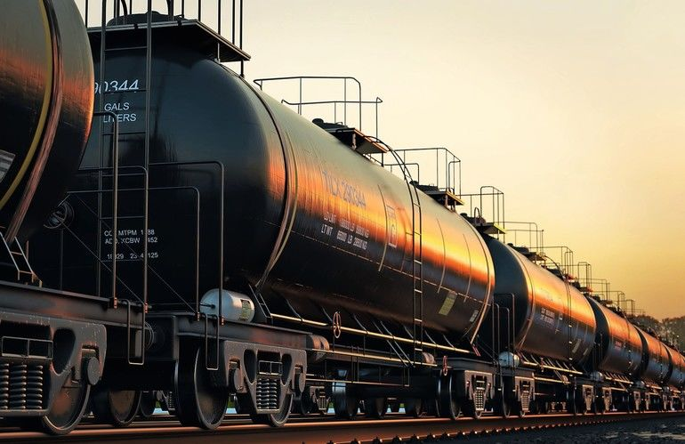 47638723_-_transportation_tank_cars_with_oil_during_sunset.