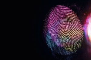 Close_up_beautiful_abstract_multi_colored_fingerprint_on__background_texture_for_design._Macro_photography_view.