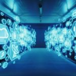 adobe_stock_-_Wide-Angle_Shot_of_a_Working_Data_Center_With_Rows_of_Rack_Servers_with_Different_Computer_Illustrative_Icons_and_Symbols_in_the_Foreground._Internet_Technology_Concept_with_Blue_Lights.