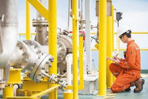 Mechanical_engineer_inspector_inspection_crude_oil_pump_centrifugal_type_at_offshore_oil_and_gas_central_processing_platform,_maintenance_and_service_for_specialist_job.