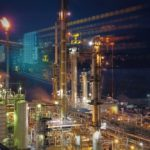 An_oil_refinery_on_the_shore_of_Burrard_Inlet_working_through_the_night._British_Columbia,_Canada_near_Vancouver.