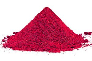 Pile_of_ground_Paprika_isolated_on_white_background._Used_to_color_rices,_stews,_and_soups,_meats.