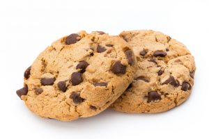 Chocolate_chip_cookie_on_white_background._