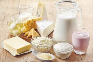 Various_fresh_dairy_products_on_wooden_background