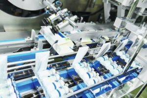 pharmaceutical_industry._Line_machine_conveyer_for_packaging_glass_bottles_ampoules_in_boxes_at__factory