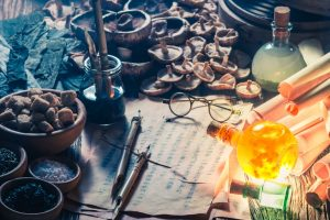Old_scrolls_and_recipe_in_vintage_alchemist_laboratory