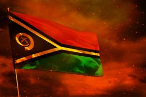Fluttering_Vanuatu_flag_on_crimson_red_sky_with_smoke_pillars_background._Vanuatu_problems_concept.